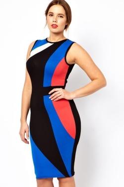 Zajímavě řešené šaty s pruhy a efektními barvami se hodí do společnosti i práce.